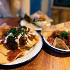 Chilli beef nachos, salt and pepper prawns and barbecue cauliflower wings (L-R) from The Ten Bells i
