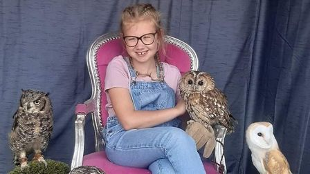 Evie loves her owls and trains them all herself.