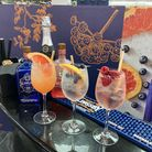 Three gin-based cocktails line the bar at the Slingsby Pop-Up