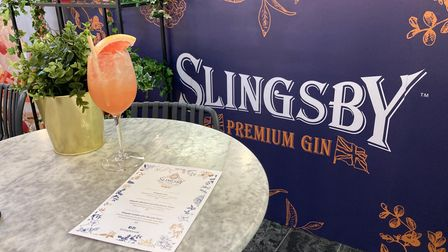A cocktail sits on a marble table at the pop-up