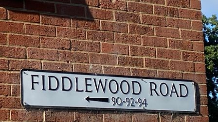 A Fiddlewood Road sign