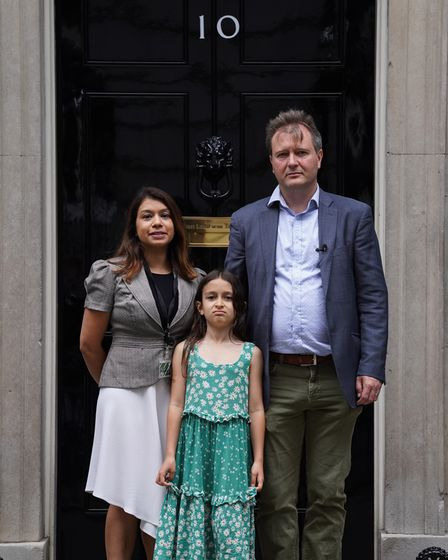 (left to right) MP Tulip Siddiq, Gabriella Ratcliffe and Richard Ratcliffe hand in a petition to 10