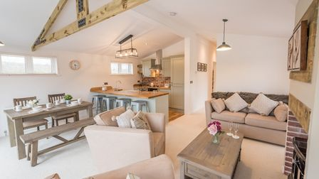 Open-plan living space and kitchen area in a luxury lodge at Homestead Lake Country Park.