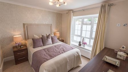 Fully furnished bedroom with fitted furniture in one of the luxury lodges for sale at Homestead Lake Country Park in Essex.