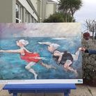 Seaton mayor Dan Ledger views some of the town's great art