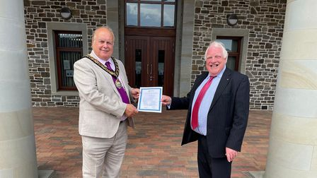 FBCA president Cllr David Marren (left) presenting Alan Jose with the Westerleigh's environmental policy statement