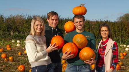 The Miller Four: Alice, Justin, Quenton and Kelly in their pumpkin patch at the family farm in Dorset