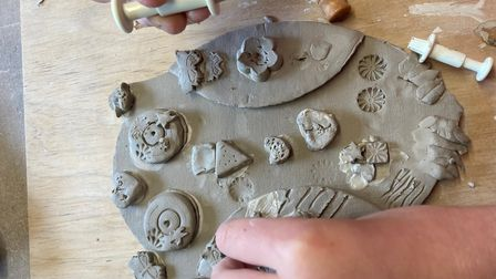 Anwen works on her owl.