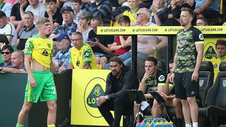 Brandon Williams of Norwich and Norwich Head Coach Daniel Farke look dejected after their side conce