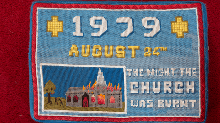 A church kneeler in Ickleton, Cambridgeshire which reads: 1979 - August 24th - The Night the Chuch was Burnt