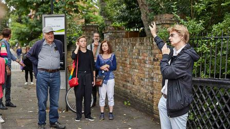Cllr Rowena Champion speaking with residents on a Footways walk.