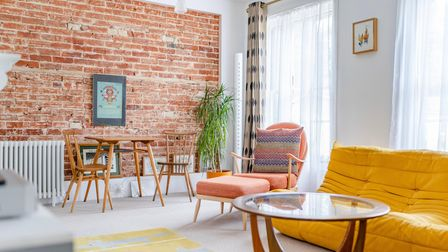Cool urban living room with exposed brick feature wall at this 3-bed apartment for sale on Trory St, Norwich