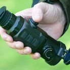 The IRay Clip CH50 thermal clip-on scope and spotter, in spotter mode, being held in Paul's hand