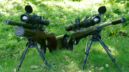 Two Cip CH50 thermal units mounted as thermal scopes on two rifles on bipods next to each other