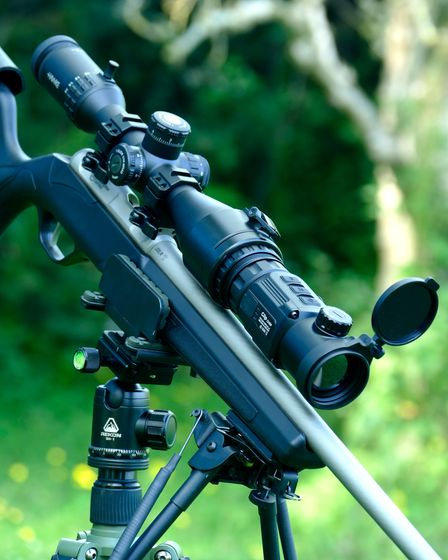 The IRay Clip CH50 mounted as a thermal scope on a rifle