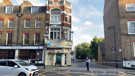 A cordon in place on Essex Road after reports of an assault at a pub