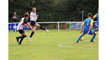 Rob Latham goes for goal for Portishead Town.