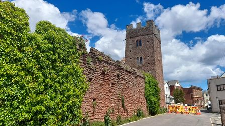 Red sandstone walls lead to Coverdale Tower