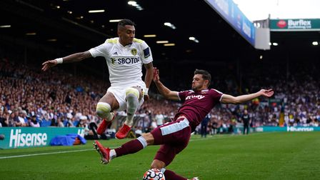 Leeds United's Raphinha and West Ham United's Aaron Cresswell (right) battle for the ball during the