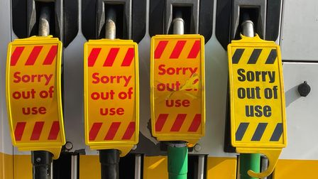 Covers on fuel pumps at a Shell filling station in Smithdown Road, Liverpool. Deliveries to supermar