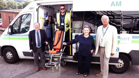 Roy Tuttle, chairman of Torbay Hospital League of Friends,and Patricia Roberts with Louis Nicholls with the stair climber