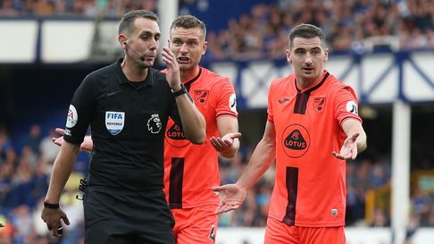 Kenny McLean of Norwich and Ben Gibson of Norwich appeal to Referee David Coote during the Premier L