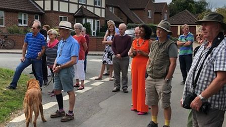 Villagers gather for the inauguration ceremony of Hemblington's new sign