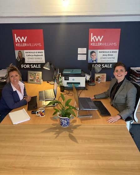 Cathryn Raybould and Jessy Bines sat at desk at Raybould & Bines, West Sussex