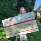 Julie Kelly with lottery cheque