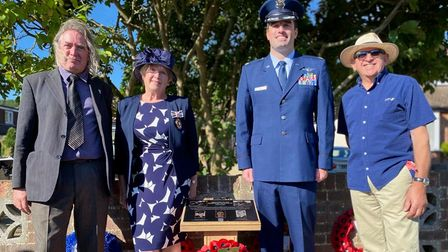 Four people - Mark Ratcliff, Rosemary Padfield DL, Major David Nan and Steve Foster - next to a memorial in Hatfield Heath