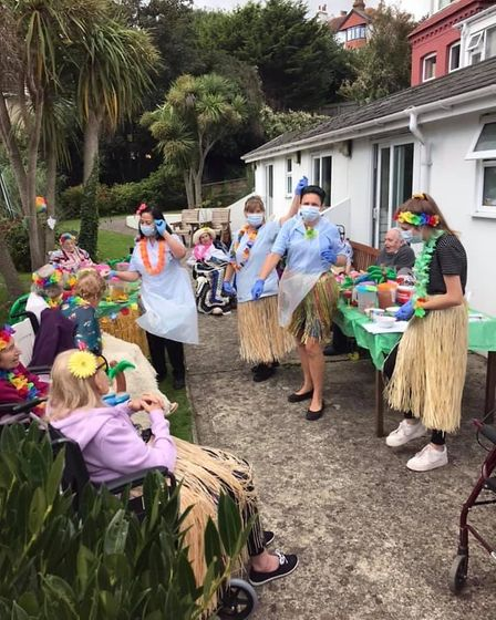 Residents and staff enjoy one of the garden parties