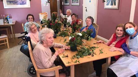 Residents making table decorations