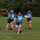 Craig Ratford of Old Cooperians kicking a conversion against Upminster