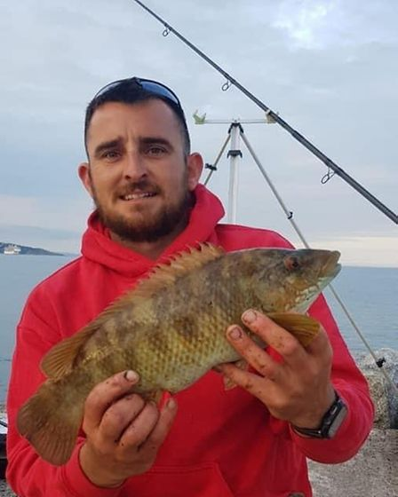 Tom Travers with a Ballan Wrasse