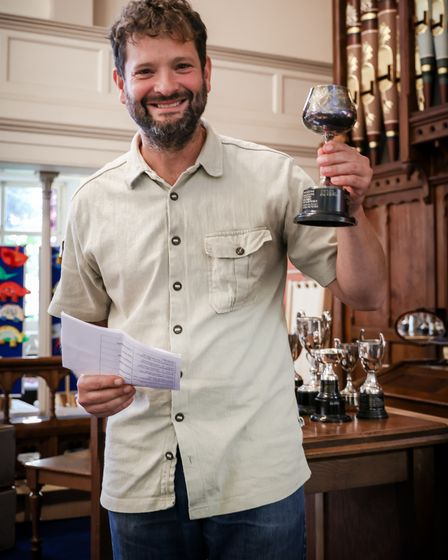 The committee chairman wins the home-made beer show at the Thaxted Gardening and Craft Show