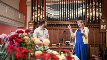 Two people on stage at the Thaxted Gardening and Craft Show in the United Reform Church