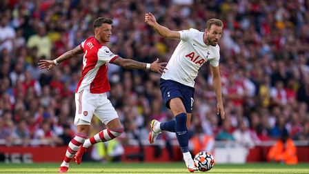 Tottenham Hotspur's Harry Kane (right) and Arsenal's Ben White battle for the ball during the Premie