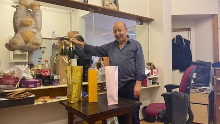 Suleyman Melit, owner of Tonys, with gifts from customers