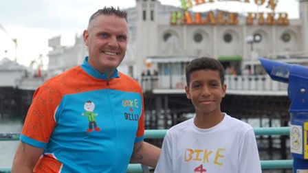 13-year-old Logan and his step-dad in front of Brighton pier
