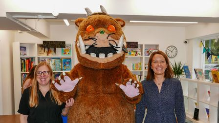 Next Page Books owners Liz Tye and Julie Anderson with the Gruffalo at their store opening on September 25, 2021 in Hitchin
