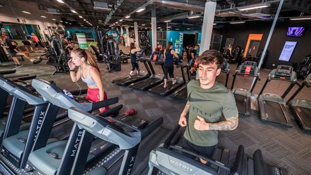 People workout at the PureGym in Leeds, Yorkshire, as indoor gyms, swimming pools and sports facilit