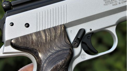 Close up of the Weihrauch HW45 Silver Star air pistol in someone's hand