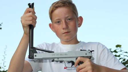 A young boy showing how easy it is to cock the barrel on the Weihrauch HW45 Silver Star air pistol