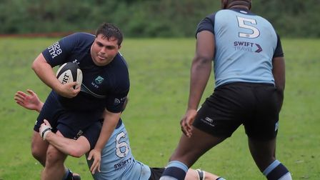 George Cosma of Eton Manor is tackled against Chingford