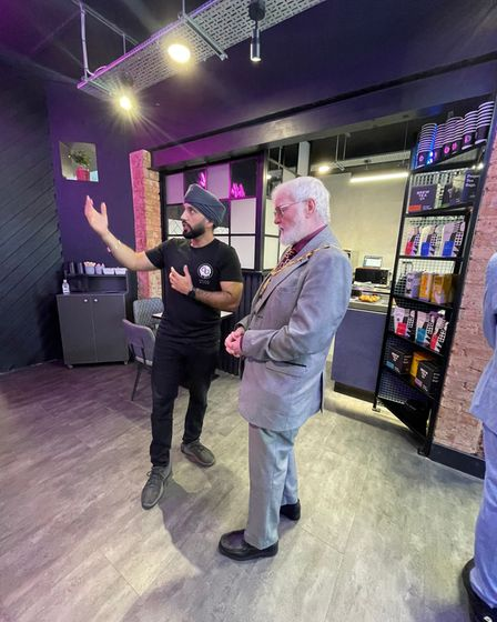 Randeep Sohal showing Cllr Roy Emmett around the coffee shop's 'edgy' and 'eclectic' interior