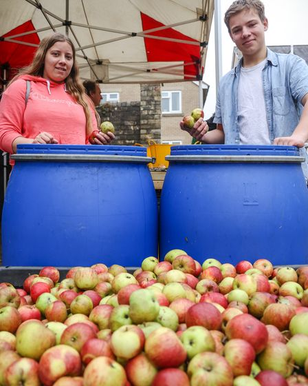 13-year-old Hermione and 15-year-old Noah help wash the apples at the Railway Arms, Saffron Walden