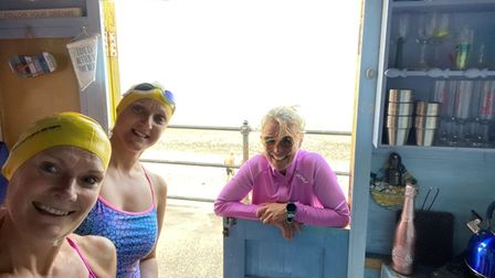 From left, Sandra Claxton, Julie Coleman and Isobel Robson at the 'Norfolk Crawlers' beach hut in Mundesley.