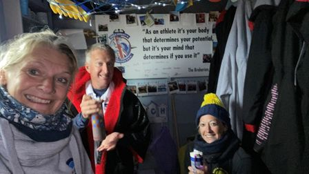 Isobel Robson, left, with husband Paul and sister-in-lawSue Ventham at the award-winning beach hut in Mundesley.