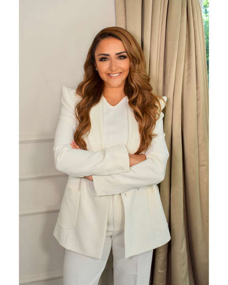 Hanna Kinsella in a white suit, looking confident