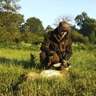 Chris Rogers deer manager crouched behind a roe buck he has culled as part of his management plan